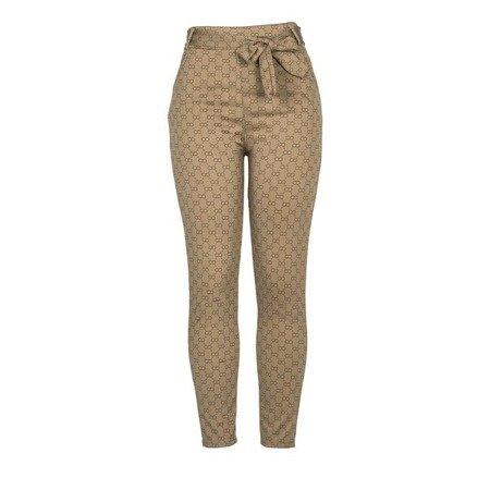 Brązowe legginsy z printem - Odzież