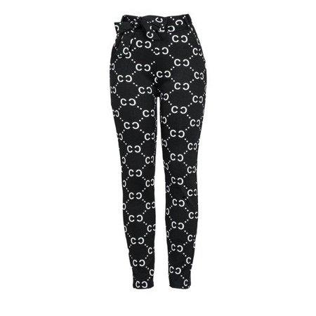 Czarne legginsy z białym printem - Spodnie