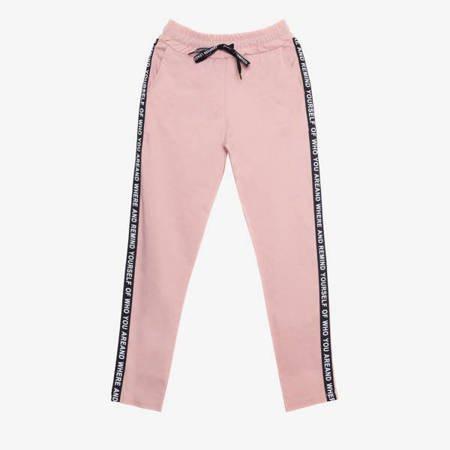 Pudrowe spodnie dresowe z lampasami - Odzież